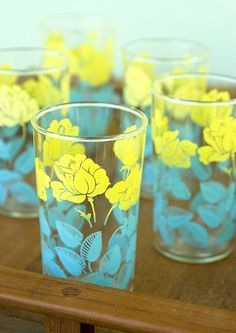 My mother has this set with the Pitcher. So very cute. Vintage Yellow and Aqua Drinking Glasses