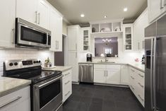 slate look floor, white cabinets | 2013 kitchen full remodel to the studs with new cabinets, granite ...