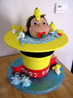 Cake made to match nursery and shower theme.  Choc and WASC cakes.  George is RKT.  Rim of hat is fondant over foam core.  Everything made from fondant and all edible.   From bottom to top cakes are 6, 7, 8, 9, 10.  Thanks for looking!
