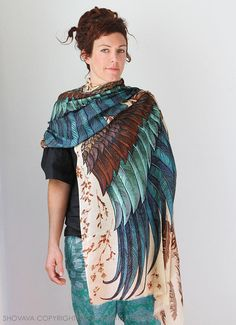 This unique bohemian wings and bird feathers shawl scarf features:  Delicately hand-painted and digitally printed Art of Wide-Spread Wings, this highly