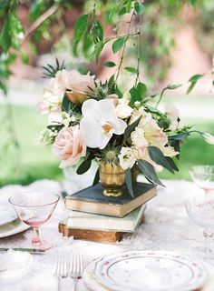 Unique Mix of Flowers in this Spring - Inspired Shoot | Wedding Centerpiece | See more on SMP:  http://www.StyleMePretty.com/2014/02/21/springtime-bridal-shoot-wiup/Photography: Judy Pak  + Matthew Ree