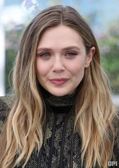 """Elizabeth Olsen arrives at a photocall for the film """"Wind River"""" during the 70th annual Cannes International Film Festival in Cannes,…"""