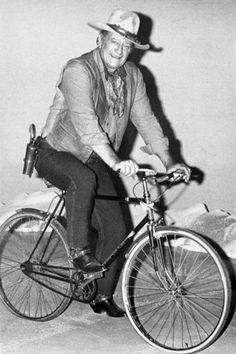 John Wayne rides a bike, not a horse.