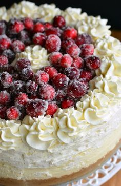 Amazing CHRISTMAS CHEESECAKE to make your holidays magic. Vanilla bean cheesecake layered with an easy cranberry jam and smooth white chocolate mousse.