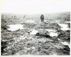 "Number One enemy during WW1: MUD. A lone Allied soldier is attempting to cross the mud field somewhere in the Ypres Salient in late summer 1917. This type of moonscape was routine all along the trench lines on the Western Front. Mud going as deep as one meter was commonplace. Due to incessant rainfall, men could disappear in ""sucking"" mud holes along with draft animals and even whole carriages."