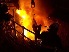 Transferring molten metal from the furnace to the ladle by Goodwin Steel Castings, via Flickr