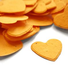 Marigold Yellow Heart Shaped Plantable Confetti. The vibrant color will pop in any favor or decoration. Daisy Giggles