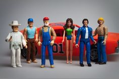 I had the General Lee and Bo and Luke.  I still remember, even though the roof opened to put them in the car, spending 10 minutes sliding the action figures in through the window.