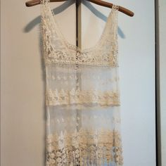 Eyelet top Cute little eyelet/see through hippy top. Never worn! Tops