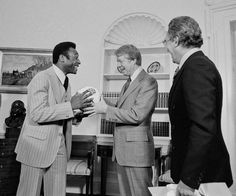 New York Cosmos soccer star Pele, left, gets a ball back from Pres. Jimmy Carter