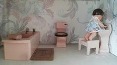My doll's house is a GeeBee DH9 made between 1964 and 1966. My doll's house bathroom furniture is by A E Twiggs.