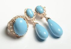 THREE ARTICLES OF FAUX TURQUOISE JEWELRY, including a ring and matching pair of earrings; each marked '925' and set with faux turquoise and faux diamonds. Ring size: 8.