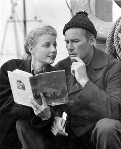Ann Sheridan and Errol Flynn on the set of Edge Of Darkness