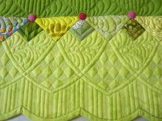 Love borders that are broken up with the quilting like this - Another example of Margaret Gunn's beautiful quilting.