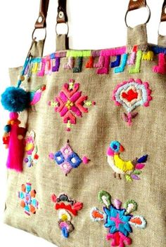 On denim bag with tassels