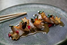 Blanched Hamachi with homemade truffle Ponzu sauce and parsley chips