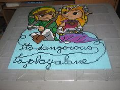 Its dangerous to play alone - Link and Zelda perler beads by ndbigdi on DeviantArt - Pattern: https://www.pinterest.com/pin/374291419008059795/