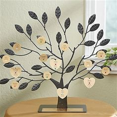 Engraved Family Tree Stand with Gold Last Name Plate provides a unique way to display your family tree. Available from Arttowngifts.com