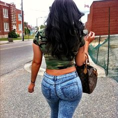 Best Pants For Curvy Women With Big Bump | Trendy Plus Size Womens Clothing acid wash blue jeans from the back skin tight skinny jeans on a thick curvy hot woman.