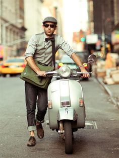 Vespa style I just dig the cuffs, the bowtie, the tweed cap, mailbag, the shoes speak volumes about a man. This ain't no Tom McKann.