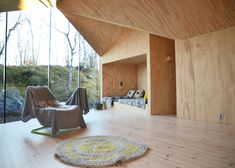 Mountain lodge by Reiulf Ramstad Architects has a V-shaped footprint that follows the terrain.