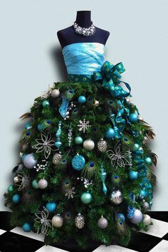 Includes dress form, custom designed and hand stiched fitted satin or lace bodice with handmade Christmas tree skirt with artificial pine