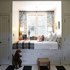 For Hattie's room under her bed, with the drawers too! Kristen Panitch Interiors - boy's rooms - built in bed, window seat bed, window seat as bed, striped rug, black and white rug, black and white striped rug,