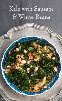 Kale with Sausage and White Beans ~ Kale sautéed with Italian sausage, onions, garlic and white beans. ~ SimplyRecipes.com