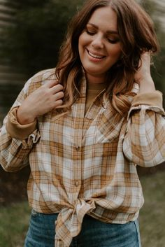 This classic plaid shirt works for all seasons! Featuring a collar with a button-down front, chest pocket, and long sleeves that you can style rolled up or down. The shirt is also made oversized for easy, effortless vibes! #shopnoragray #noragrayboutique #onlineboutiques #midwestboutiques #indianaboutiques #fortwayneindiana #berneindiana #fallfasion #falltrends2021 #fallstyle #womensflannelshirts #womensflannel #plaidshirts #fallshakets