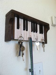 Check out this item in my Etsy shop https://www.etsy.com/listing/257505585/piano-key-rack: