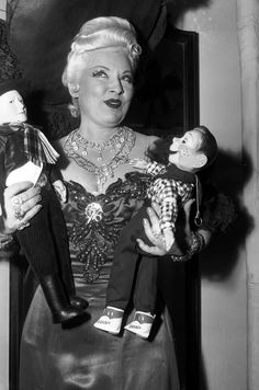 Mae West holding Hopalong Cassidy & Howdy Doody dolls in Chicago, Dec. 12, 1951. — Chicago Tribune historical photo via http://galleries.apps.chicagotribune.com/chi-20th-century-entertainers-20130125/