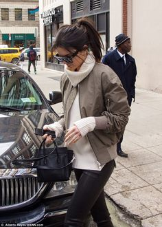 So chic: Kendall carried a miniature Celine handbag and tied her dark tresses into a high ...