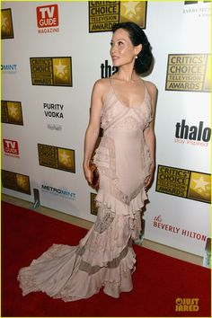 Lucy Liu.  Critics' Choice TV Awards 2012.  Atelier Versace gown.  Neil Lane jewelry.  Roger Vivier bag.