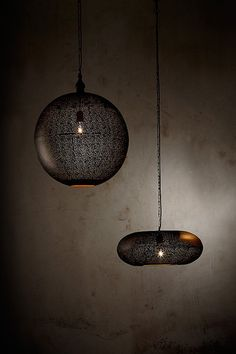 Crafted from etched metal, the Galaxy range is available in a variety of shapes and sizes. The black finish has a gold interior creating a warm glow.