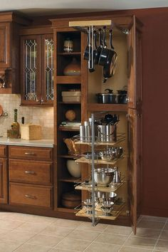 Keep your kitchen organized with the help of this cabinet, featuring a full extension pots and pans rack and pantry pullout.