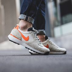 cheaper a45be ad2b1 Nike Lavadome Ultra  Stone Grey Safety Orange-Sail-Light Bone  available  now in-store and online Zurich ⬆ link in bio.