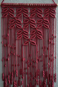 Wall panels handmade macramé technique. Material: 100% polyester. Color: beetroot. Strap: natural wood - pine. Dimensions: The length of the strap to the bottom, including the thread - 80cm / 31,5 inches Width - 38cm / 15 inches