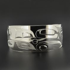 """'Killerwhale' Sterling Silver Bracelet by Haida artist Gerry Marks. 6"""" x 1"""", $1,300.00 Cad. Available at Lattimergallery.com."""