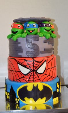 Superhero, Ninja Turtle, Batman, Spiderman three tiered birthday cake.