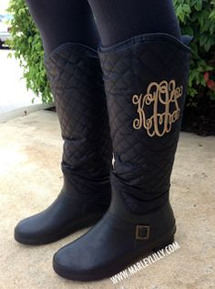 Black, quilted monogrammed boots for fall