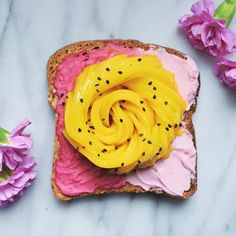 Beet infused almond milk cream cheese ombré toast topped with a mango rose This dish was inspired by two incredible food artists - Karen of @secretsquirrelfood is the fruit rose goddess and Adeline of @vibrantandpure is the queen of toast  I'm constantly inspired by all the #foodies on Instagram and love being part of this community! So this is my entry for the #alphafoodiefuncomp being held by the very talented @alphafoodie