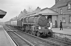 It's a long time since British station staff wore smart white shirts and ties. My local stationmaster was always particularly well dressed. In the sixties this train station had 6 staff. Now it is staffed by just 2 ticket clerks during daylight hours. New Milton, Hampshire, UK.