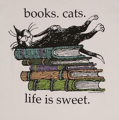 books and cats - a marriage made in heaven (except when the cat is sitting in the middle of the page you want to read)