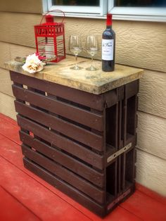 Rustic outdoor wine bar from recycled wooden pallets & pavers..