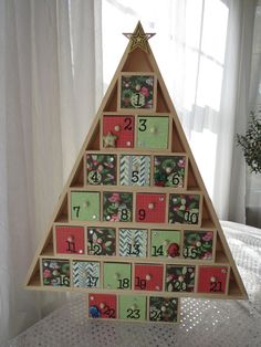 Topped with a gold star!    Wood Christmas tree shaped advent calendar measures approximately 20 tall x 16 wide x 2.5 deep (50.8 x 40.6 x 6.4