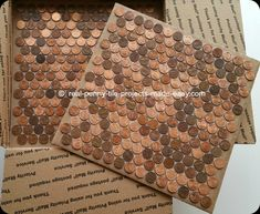 Tile sheet of pennies shown on a 12x12 in. cardboard to show size difference to our penny sheet at 90% or a square foot.