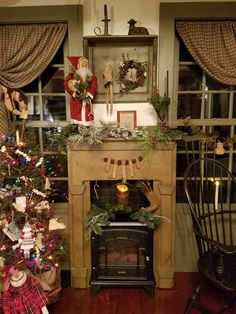 Almost along the idea I'm thinking, but without holiday decor. Does this belong in an office? Primitive Fireplace, Faux Fireplace, Primitive Mantels, Rustic Fireplaces, Primitive Country, Cottage Christmas, Prim Christmas, Christmas Scenes, Antique Christmas