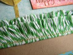 Using baker's twine to create 'grass' for a scrapbook page layout design or card - so clever!