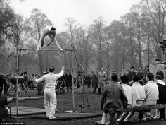 Members of the British gymnastics team practice on the high bar in Hyde Park for the 1948 Olympic Games