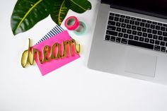 Simply styled desk featuring a laptop, colorful notecards and washi tape, gold dream paperweight and a tropical plant. Colorful Desk, Dream Desk, Paper Weights, High Quality Images, Note Cards, Pink, Branding, Social Media, Creative